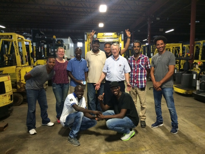 Jo (second from the left) with some of the refugees who just completed forklift training!